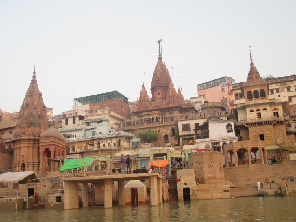 Palace towers, temples, stairs, and the brown water of the holy Ganges
